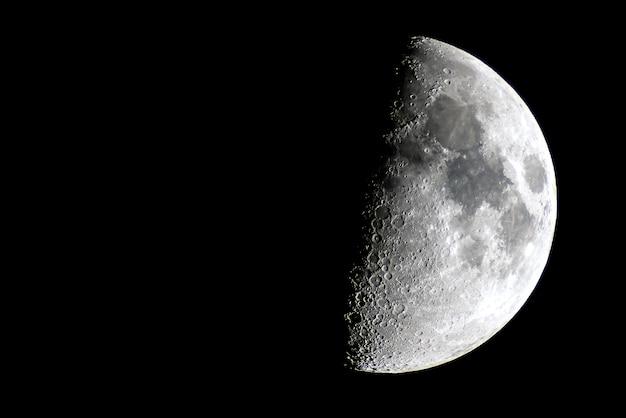 Half moon over a night sky