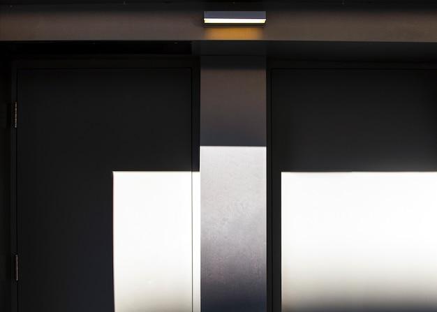 Half-open black and white doors