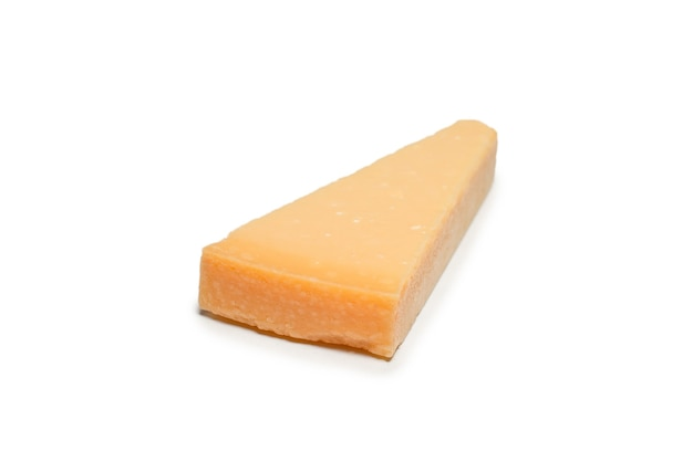 Half of parmigiano cheese isolated on a white background. top view.