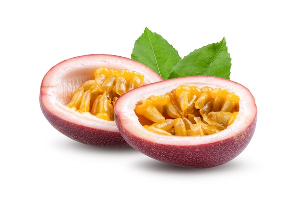 Half passion fruit with leaves isolated