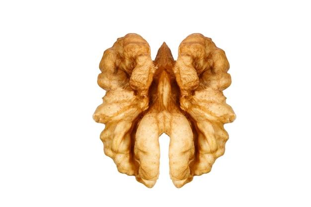 Half peeled walnut isolated on white background. high quality photo