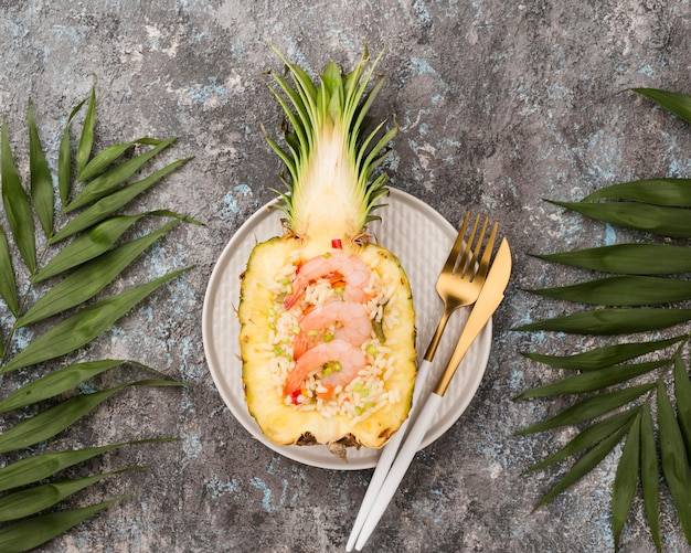 Half of pineapple with seafood