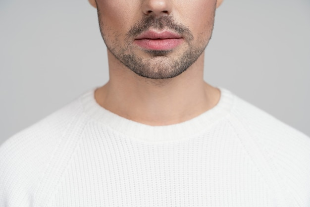 Half portrait of queer person in white blouse