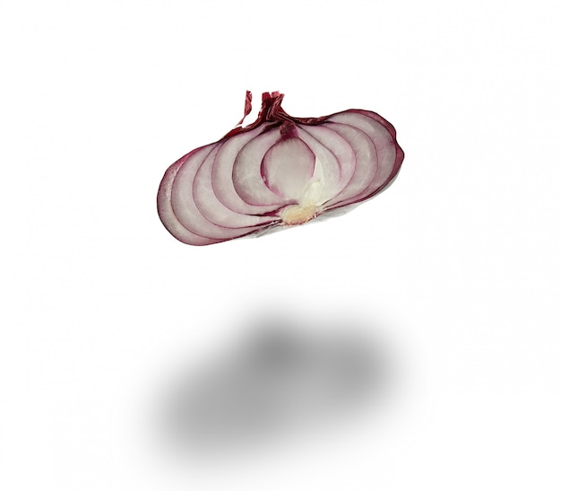 Half red onion in husk isolated