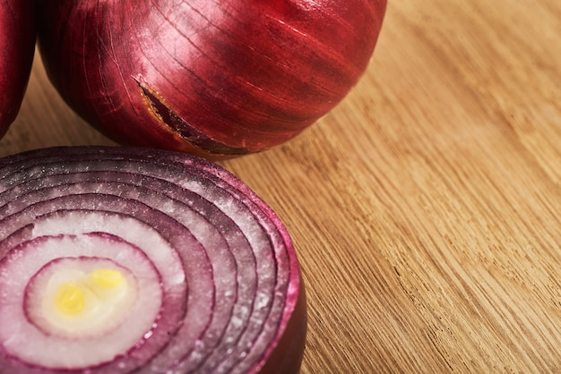 Half red onion on a wooden.