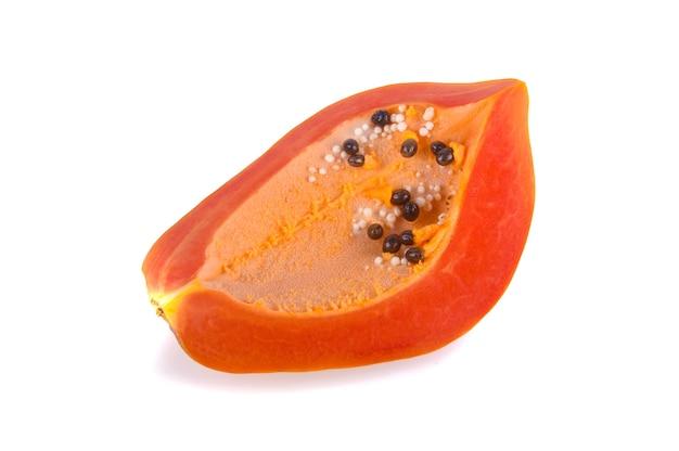 Half of ripe papaya fruit with seeds isolated on white background