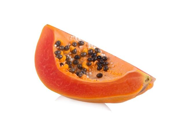 Half of ripe papaya fruit with seeds isolated on white.