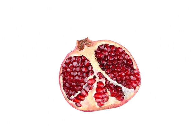 Half of ripe pomegranate isolated on a white background
