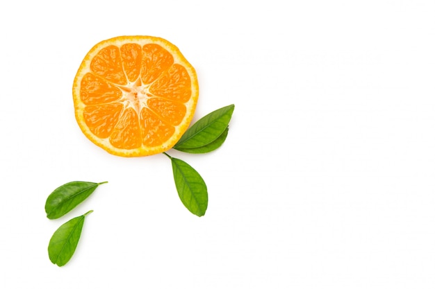 Half tangerine with leaf on a white isolated background. fresh, bright fruits. top view. flat lay