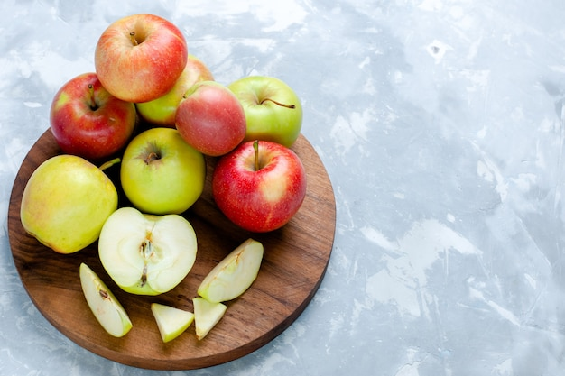 Half-top view fresh apples ripe mellow fruits on light-white desk fruit food vitamine color fresh tree