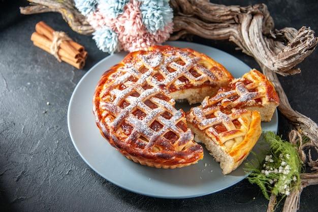 Half-top view tasty fruity pie with jelly on dark background biscuit sweet pie oven dessert bake dough sugar cake