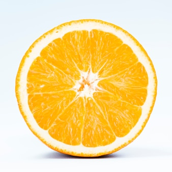 Half of tropical orange on white background