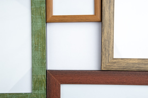 Halh shot view of empty picture frames on white with free space