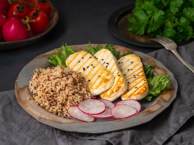Halloumi, grilled cheese with quinoa, salad, radish.