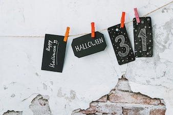 Halloween arrangement with black cards with inscriptions