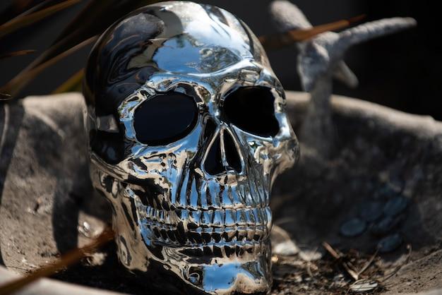 Halloween background. metallic human skull close up.