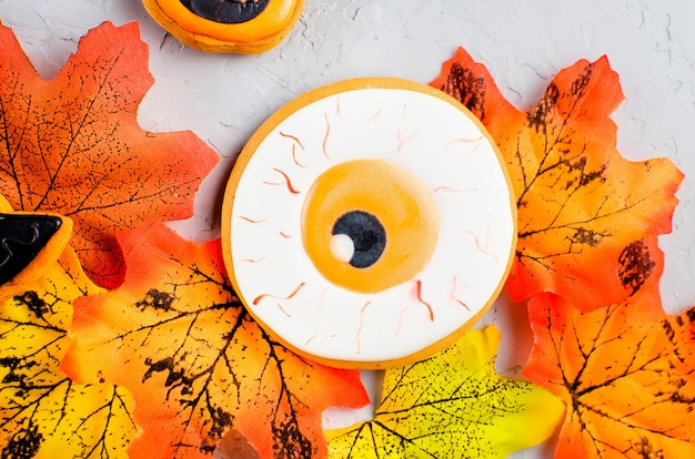 Halloween background with cookies and leaves