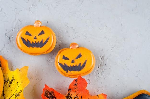 Halloween background with cookies, pumpkin, leaves