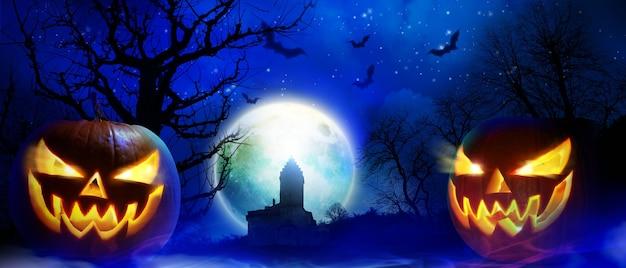 으스스한 밤에 묘지가 있는 할로윈 배경.