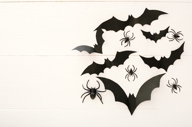 Halloween background with paper bats, spiders. flat lay copy space