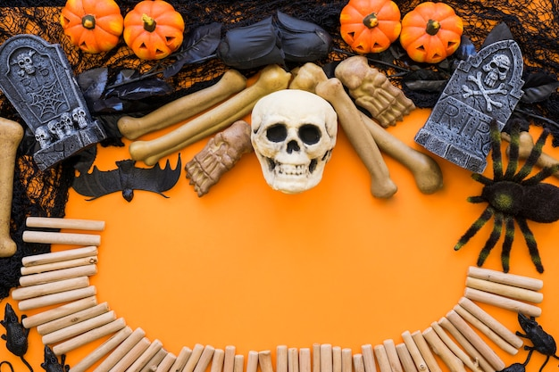 Halloween background with skull and sticks