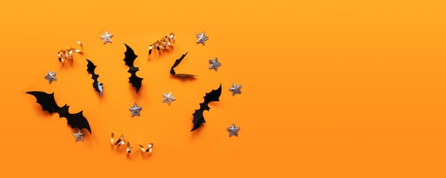 Halloween banner with black but on an orange surface, top view