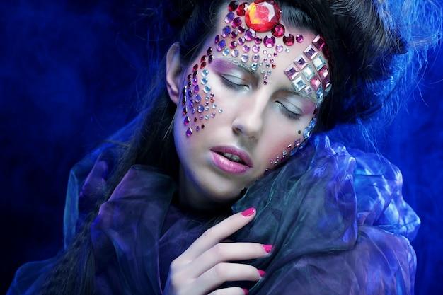 Halloween beauty style woman makeup, fantasy dream.