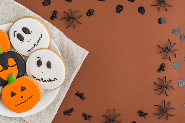 Halloween cakes on plate placed on linen tablecloth