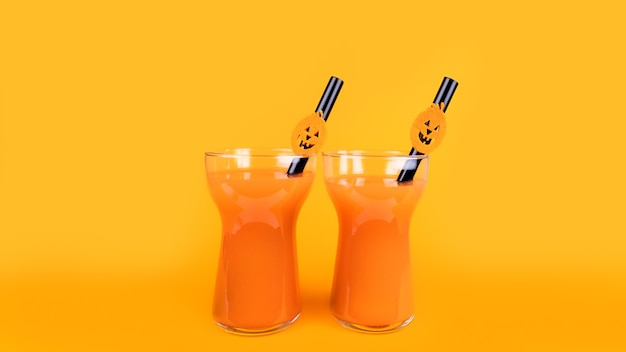 Halloween carbonated orange beverage in glass decorated with jack-o-lantern pumpkin