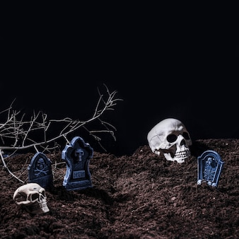 Halloween cemetery with tombstones and skulls