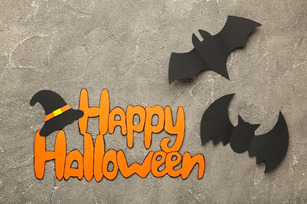 Halloween composition with bats on grey background. view from above. top view