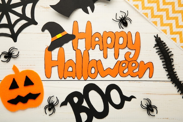 Halloween composition with bats and pumpkins on white background. inscription happy halloween