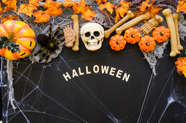 Halloween composition with letters and skull