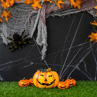 Halloween composition with net and pumpkins