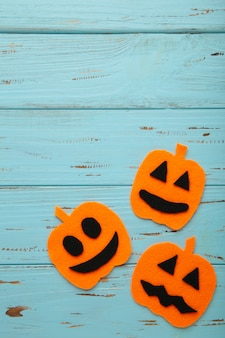 Halloween composition with pumpkins on blue wooden background. view from above.