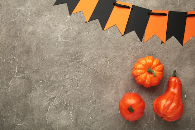 Halloween composition with pumpkins on grey background. view from above.
