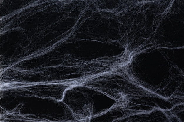 Концепция хэллоуин абстрактная паутина на черном фоне.