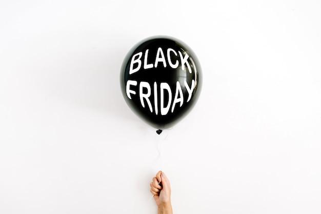 Halloween concept. one black balloon in girl's hand