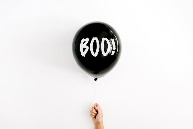 Halloween concept. one black balloon in girl's hand Premium Photo