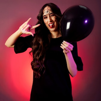 Halloween concept with happy girl holding balloon