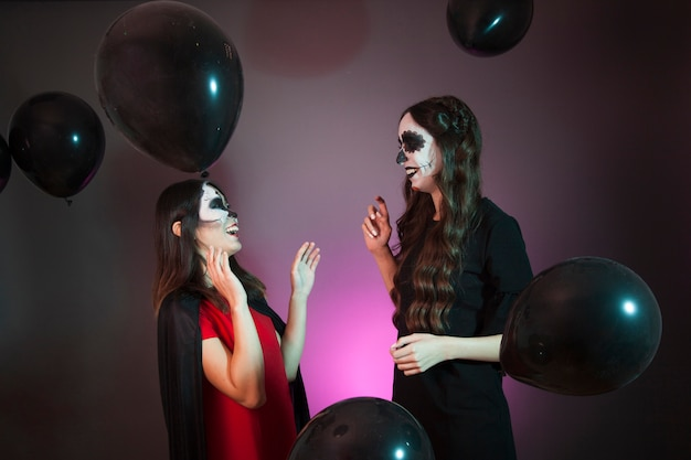 Halloween concept with laughing women and balloons