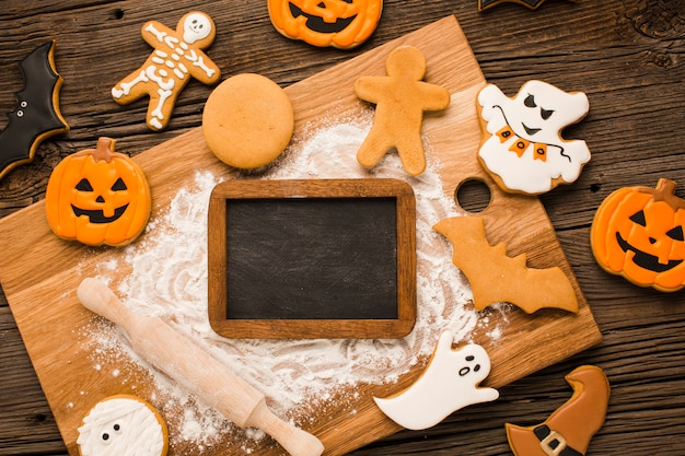 Halloween cookies on a wooden board