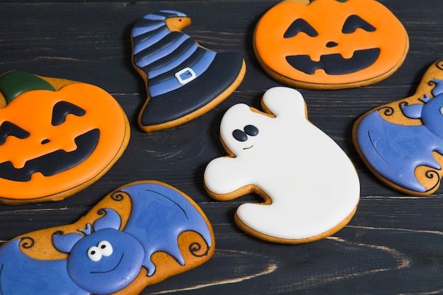 Halloween cookies on wooden table