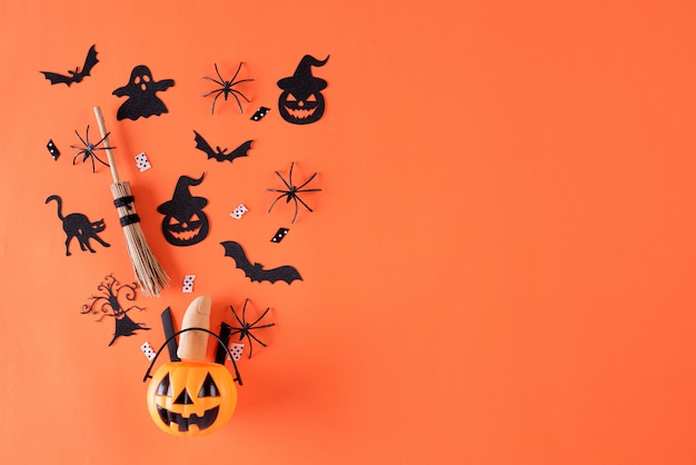 Halloween crafts on orange background with copy space.