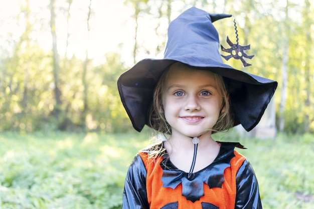 Halloween cute girl going to collect candy trick or treating guising jack o lantern celebrate