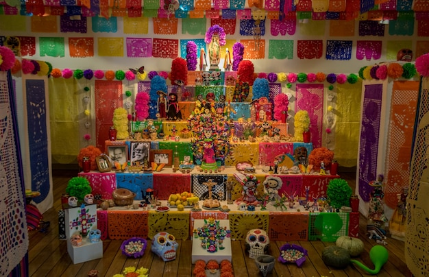 Halloween - day of the dead (dia de los muertos) altar with sugar, skulls, angels and candles