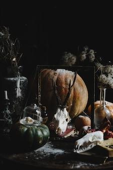 Halloween decor. Old pumpkins, pomegranates, apples