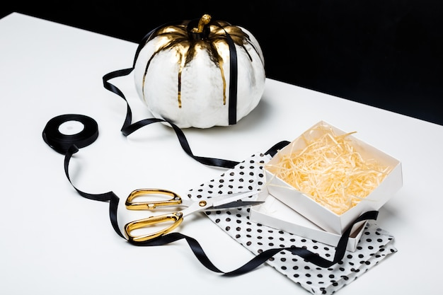 Halloween decor on white table over black surface