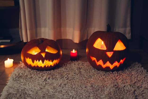 Halloween decoration. carved pumpkins with candles on kitchen. jack-o-lantern.
