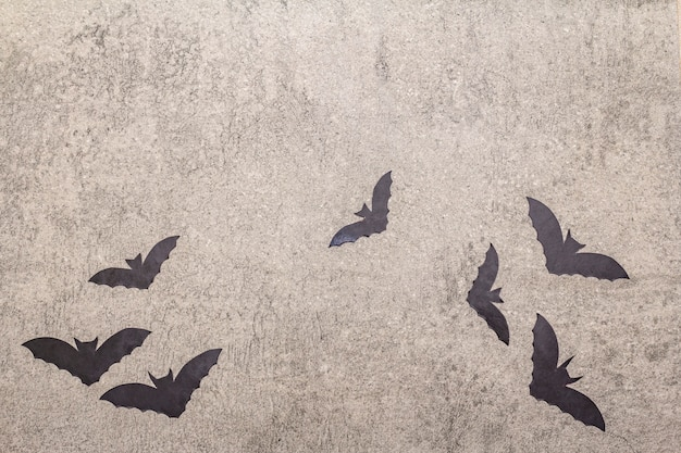 Halloween decoration concept - black bats on gray stone concrete background